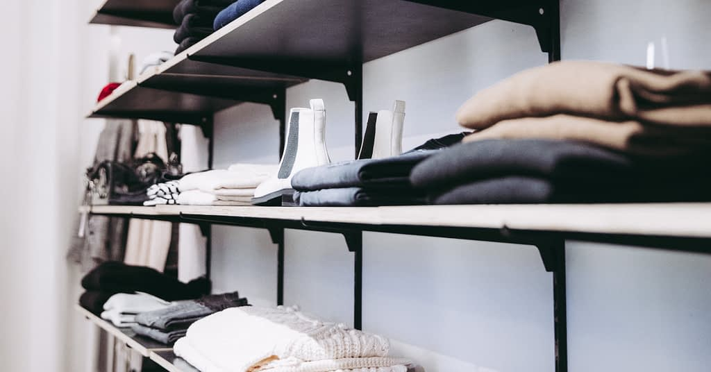 Clothing on a shelf in a store