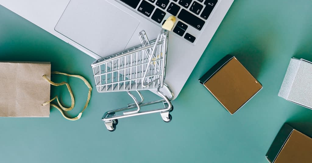 eCommerce cart and computer
